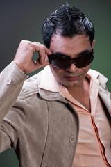 macho man taking off sunglasses