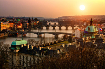 Foto auf Gartenposter Prag Panoramic view on Charles bridge and sunset Prague lights.