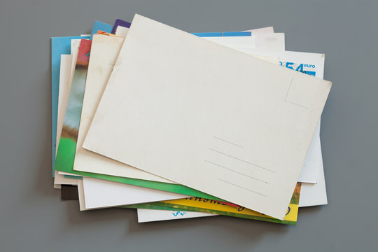 Pile of colorful cards on gray background