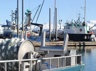 Commercial fishing boat with a net reel in the harbor