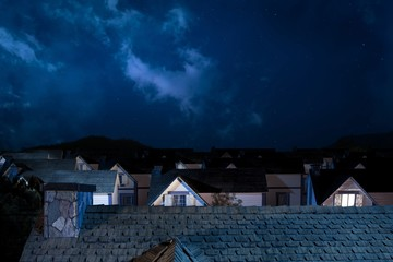 roof of house at night with houses on background