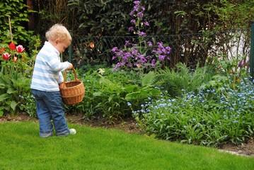 Blond child hidding easter eggs