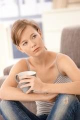 Casual woman drinking tea