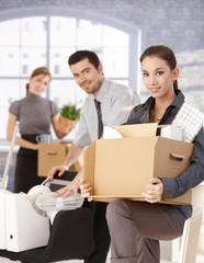 Happy businesspeople moving to new office