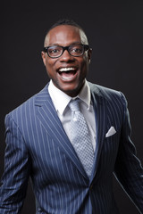 Screaming black business man wearing suit and glasses