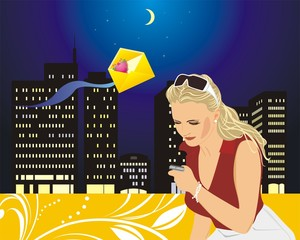 Woman with a mobile telephone on the background of night city