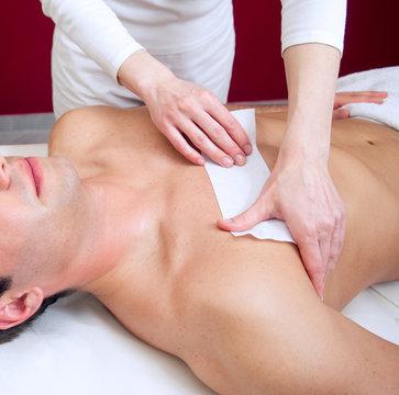 Waxing man's torso