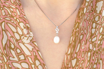 White pearl pendant on a silver chain