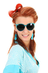 Young woman with blue sunglasses