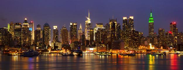 New York City midtown skyline panorama at night, USA