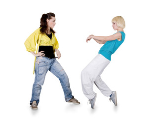 Teenager girls dancing hip-hop over white background