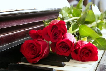 classic red roses on piano vintage romantic valentines