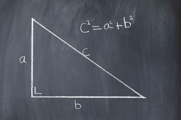 Right triangle with pythagorean formula on a blackboard