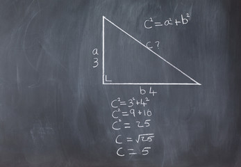Right triangle with pythagorean formula and calculations on a bl