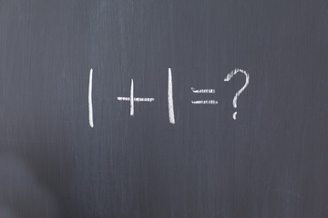 """Blackboard with """"1+1=?"""" written on it"""