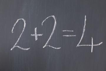 """Blackboard with """"2+2=4"""" written on it"""