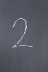 """Blackboard with """"2"""" written on it"""