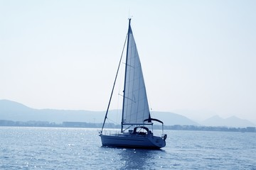 sailboat sailing in blue mediterranean sea