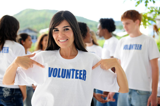 happy volunteer woman and group