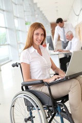 Businesswoman in wheelchair at work