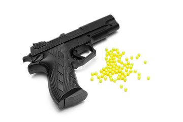Toy gun with pellets isolated