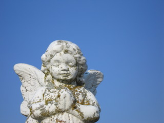 Angel statue on the blue sky