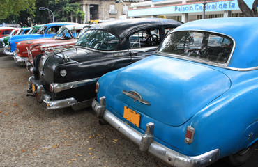 Photo on textile frame Old cars Vintage Cars Parked in a street of Havana, Cuba