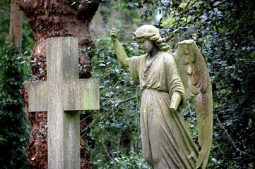 Angel and cross statues in Hampstead Heath, London