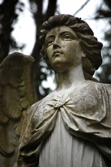 Angel statue in a graveyard at Highgate Cemetery, London