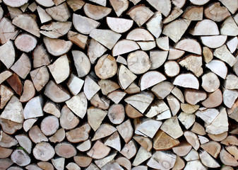 A Neat Pile of Wooden Logs for Firewood.
