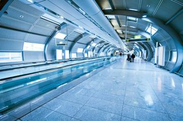 indoor walkway with blurred people