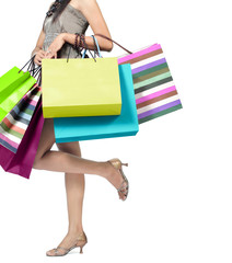 woman carrying a lot of shopping bags