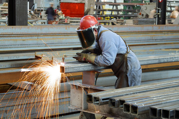 Steel Worker cutting with acetylene torch