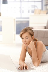 Casual woman using laptop computer