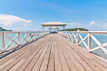 White bridge stretching to the sea