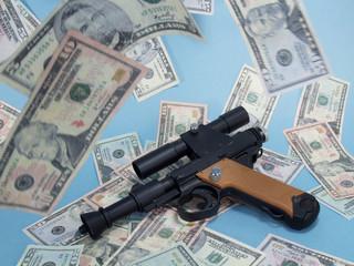 Gun on Pile of Cash