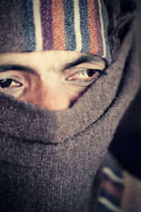Indian man covered face by woolen scarf