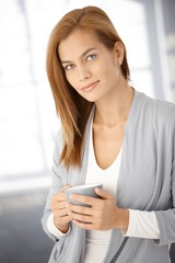 Portrait of attractive woman with tea mug