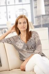 Portrait of beautiful woman on sofa