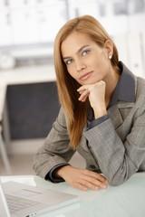 Smart businesswoman at desk