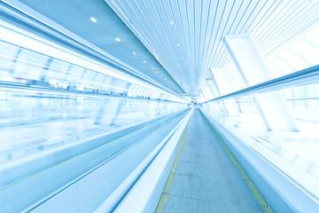 futuristic escalator inside contemporary airport