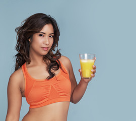 Fitness woman holding orange juice