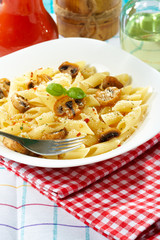 Pasta penne with mushrooms and basil