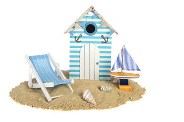 Beach hut with sailing boat and chair