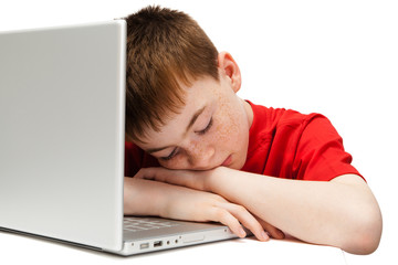 sleeping boy with a laptop