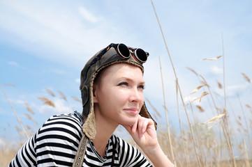 Young woman wearing aviator hat