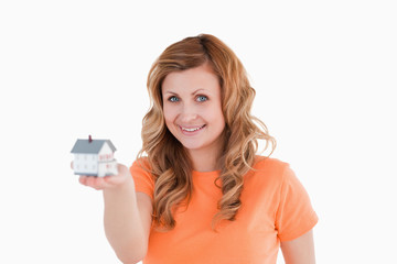 Attractive woman holding an house model