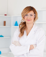 Cute blond-haired scientist posing