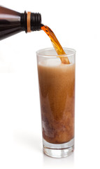 flow of kvass in glass with froth