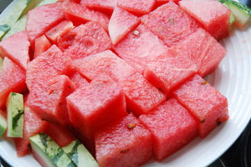 Appetizing slices of watermelon isolated on plate